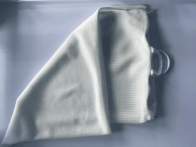 SafeSleep Breathe-Through Crib Mattress Topper Laundry and storage bag