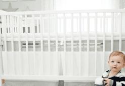 SafeSleep Crib Mattress gray base with white topper in classic white crib