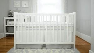 Safe Sleep Breathe-Through Crib Mattress in Gray in white crib