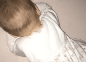 Safe Sleep Breathe-Through Crib Mattress testimonial by Melisa Depenbrock showing her baby face straight down on crib mattress