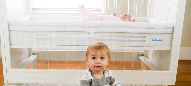 SafeSleep Crib Mattress showing brother and sister